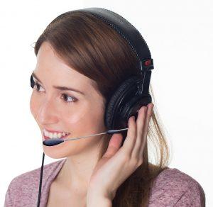 woman wearing a headset speaking